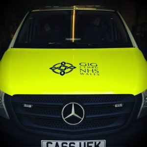 Example of part of the NHS Wales Vehicle Livery – image shows bonnet wrapped in fluorescent vinyl with log in vinyl cut lettering